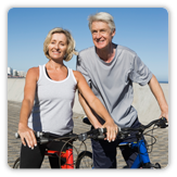 Photo of man and woman riding bikes